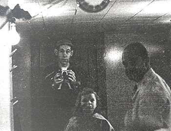 Eliot Taylor with barber and child, 1940s